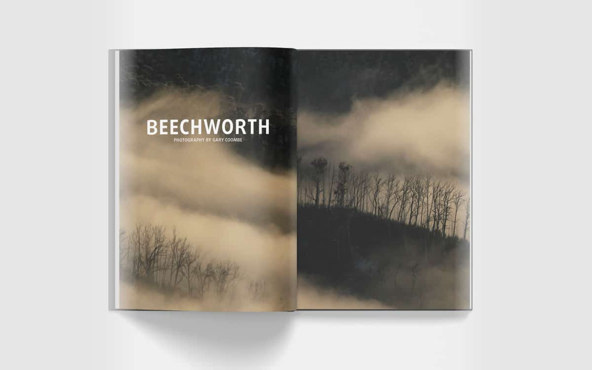 Open Beechworth book to inside cover and foggy mountains