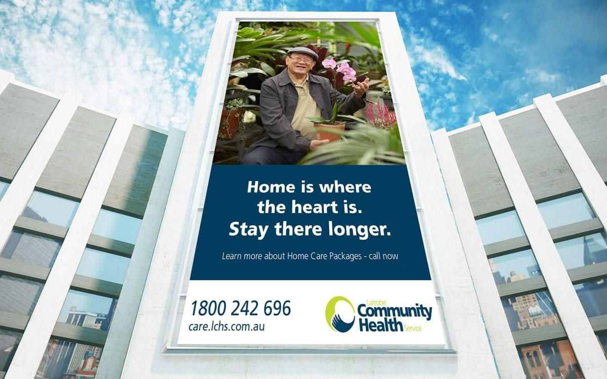 Latrobe Community Health building billboard of man with flowers