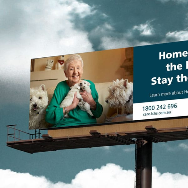 Latrobe Community Health billboard with lady and dogs